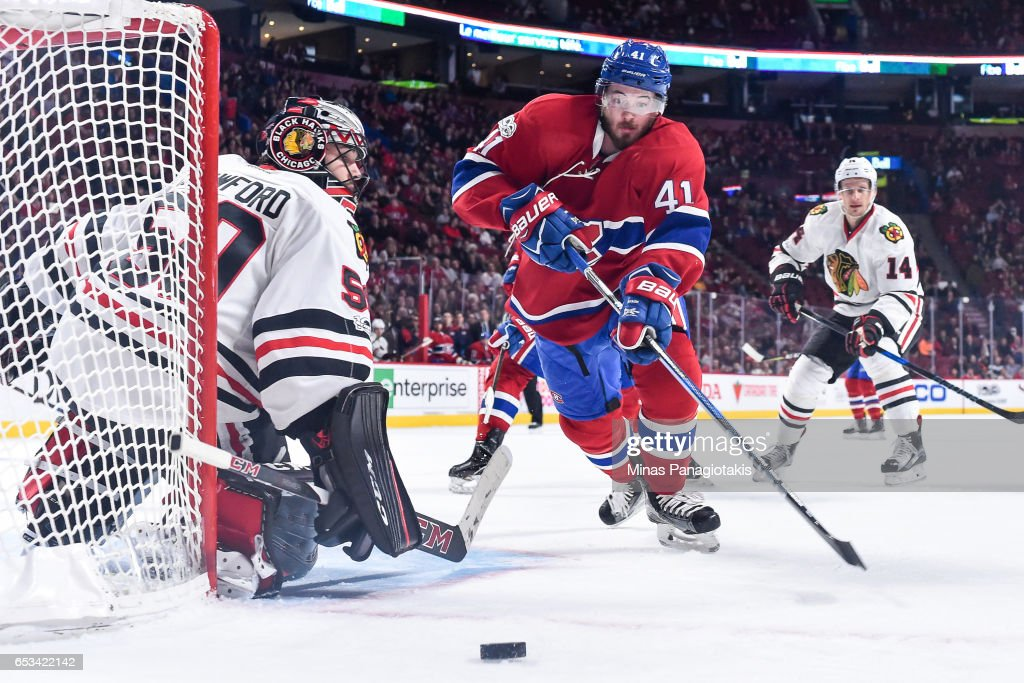 Goaltender Corey Crawford #50 of the Chicago Blackhawks tries to get into position while Paul Byron #41 of the Montreal Canadiens skates for the puck during the NHL game at the Bell Centre on March 14, 2017 in Montreal, Quebec, Canada. The Chicago Blackhawks defeated the Montreal Canadiens 4-2.