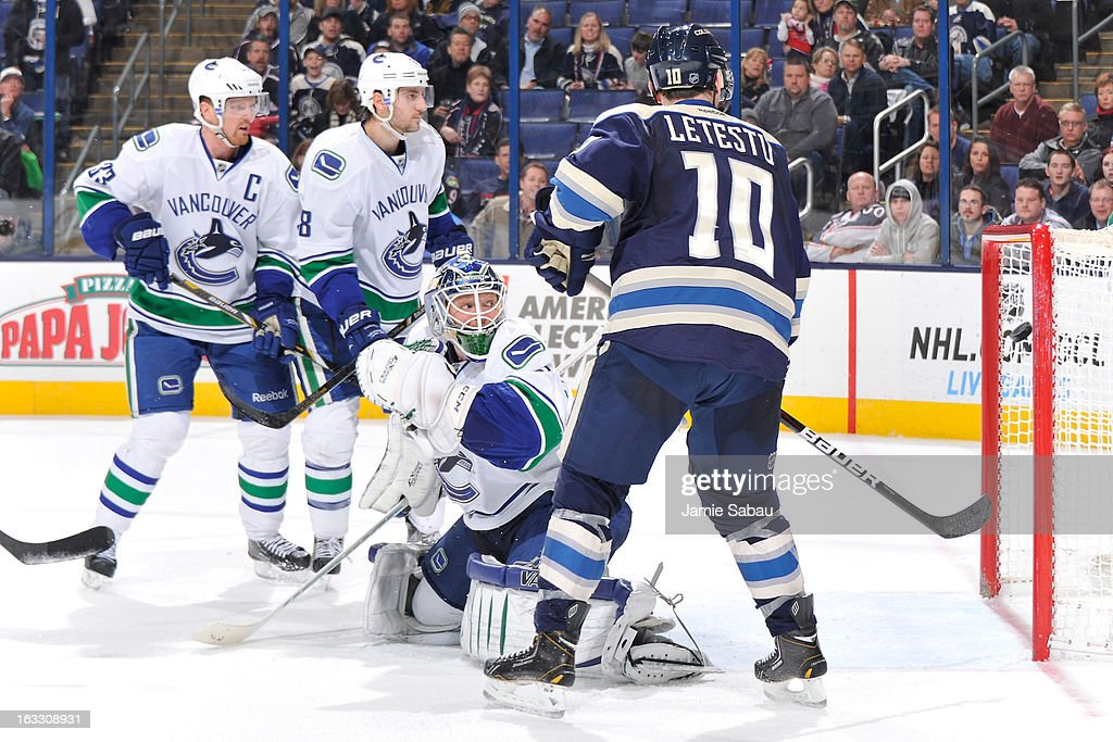 Goaltender <a gi-track='captionPersonalityLinkClicked' href=/galleries/search?phrase=Cory+Schneider&family=editorial&specificpeople=696908 ng-click='$event.stopPropagation()'>Cory Schneider</a> #35 of the Vancouver Canucks looks back as a shot from Matt Calvert #11 of the Columbus Blue Jackets goes in to end overtime on March 7, 2013 at Nationwide Arena in Columbus, Ohio. Columbus beat Vancouver 2-1 in overtime.