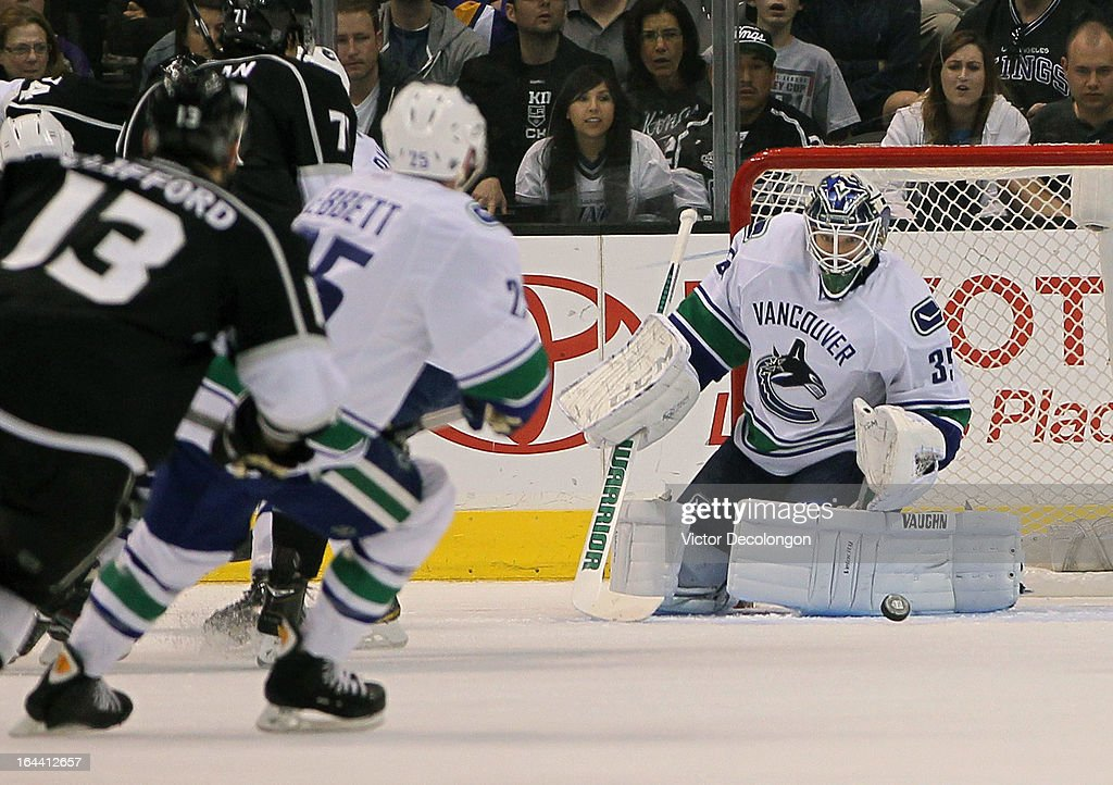 Goaltender <a gi-track='captionPersonalityLinkClicked' href=/galleries/search?phrase=Cory+Schneider&family=editorial&specificpeople=696908 ng-click='$event.stopPropagation()'>Cory Schneider</a> #35 of the Vancouver Canucks makes a save in the first period against Los Angeles Kings during the NHL game at Staples Center on March 23, 2013 in Los Angeles, California. The Canucks defeated the Kings 1-0.
