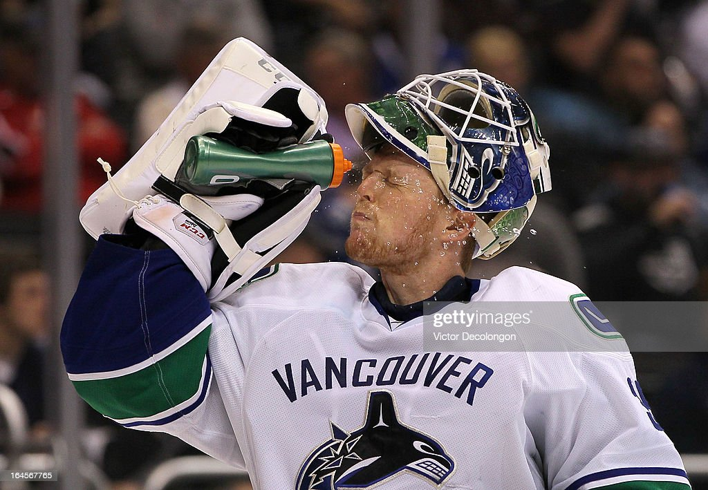 Goaltender Cory Schneider #35 of the Vancouver Canucks takes a water break during the NHL game against the Los Angeles Kings at Staples Center on March 23, 2013 in Los Angeles, California. The Canucks defeated the Kings 1-0.