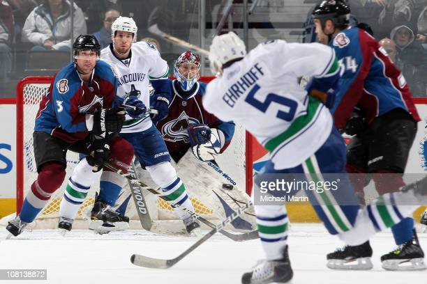 Goaltender Craig Anderson of the Colorado Avalanche watches the shot of Christian Ehrhoff of the Vancouver Canucks as Ryan O'Byrne of the Avalanche...