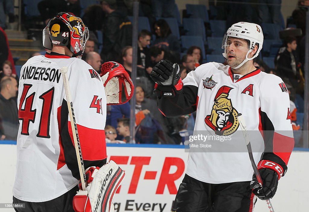 Goaltender <a gi-track='captionPersonalityLinkClicked' href=/galleries/search?phrase=Craig+Anderson&family=editorial&specificpeople=211238 ng-click='$event.stopPropagation()'>Craig Anderson</a> #41 of the Ottawa Senators is congratulated by teammate Chris Phillips #4 on their win against the New York Islanders at Nassau Veterans Memorial Coliseum on February 20, 2012 in Uniondale, New York. The Senators defeated the Islanders 6-0.