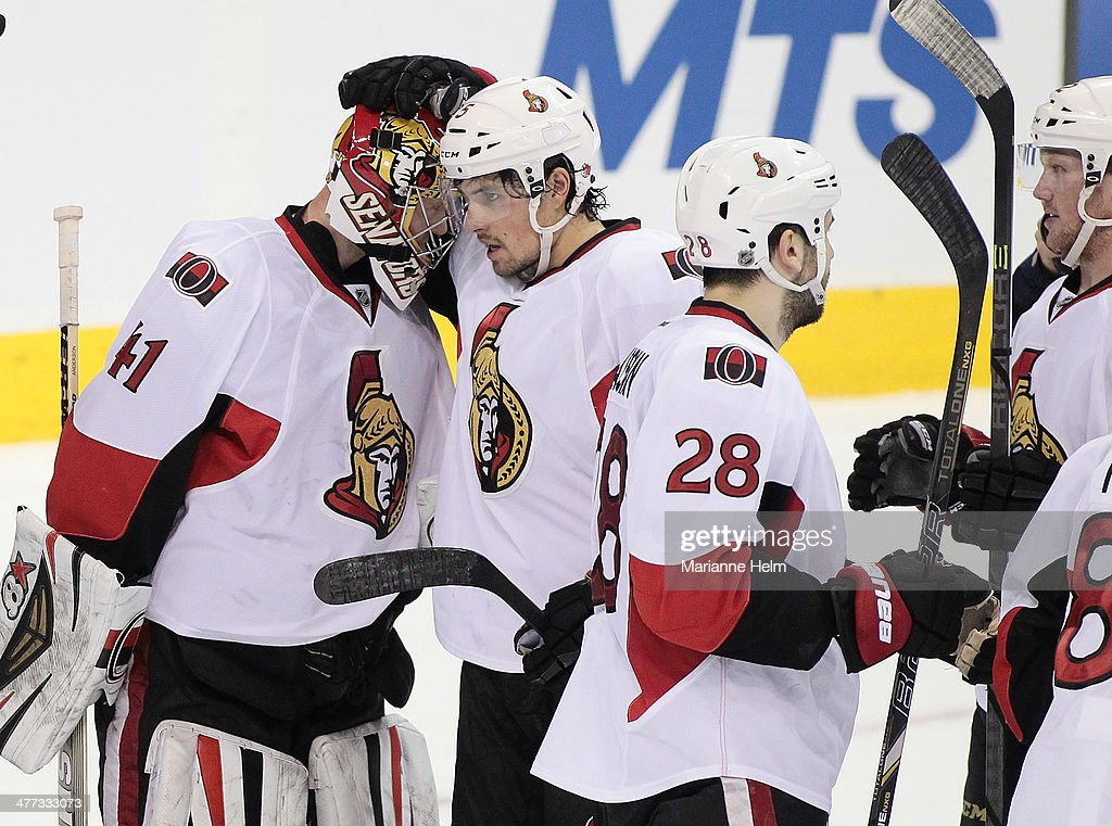 Goaltender <a gi-track='captionPersonalityLinkClicked' href=/galleries/search?phrase=Craig+Anderson&family=editorial&specificpeople=211238 ng-click='$event.stopPropagation()'>Craig Anderson</a> #41 of the Ottawa Senators is congratulated by teammate Zack Smith #15 after third-period action in an NHL game at the MTS Centre on March 8, 2014 in Winnipeg, Manitoba, Canada.