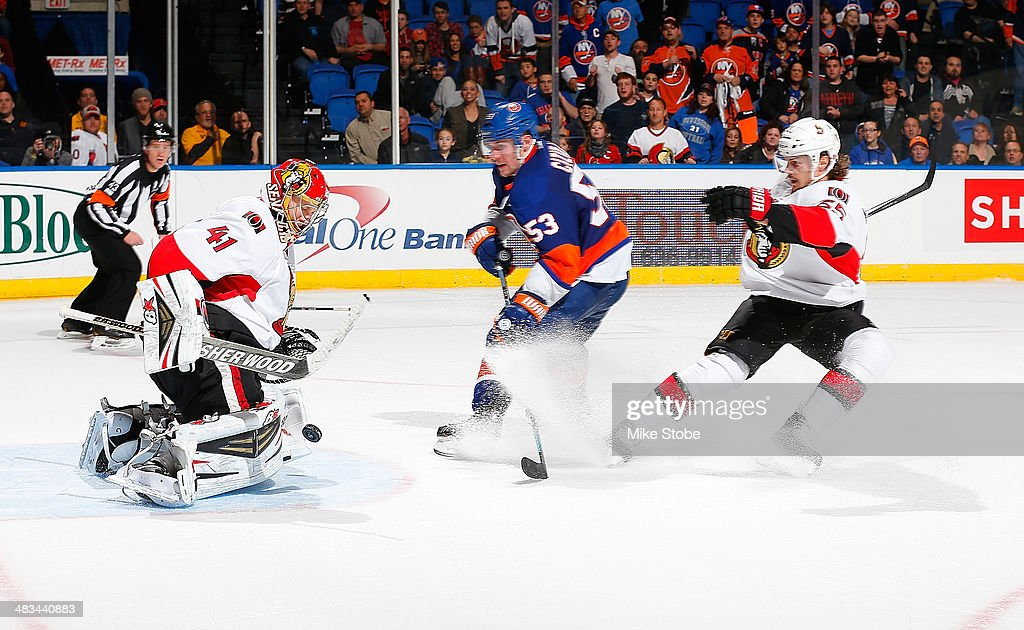 Goaltender Craig Anderson #41 of the Ottawa Senators makes a pad save on a breakaway by Casey Cizikas #53 of the New York Islanders at Nassau Veterans Memorial Coliseum on April 8, 2014 in Uniondale, New York.