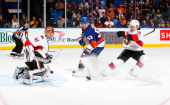 Goaltender Craig Anderson of the Ottawa Senators makes a pad save on a breakaway by Casey Cizikas of the New York Islanders at Nassau Veterans...