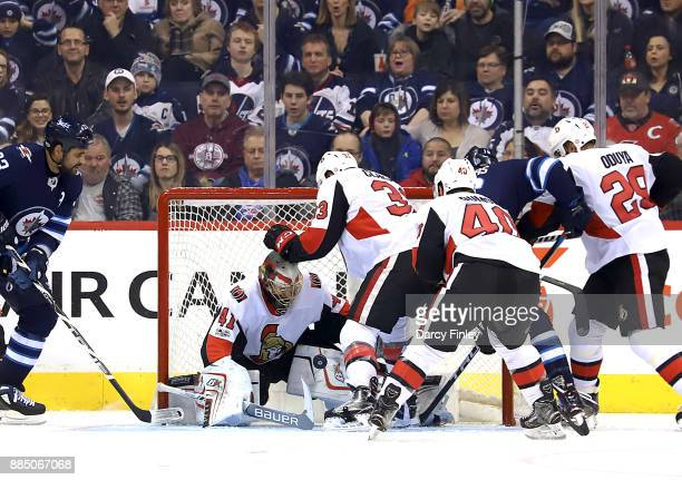 Goaltender Craig Anderson of the Ottawa Senators makes a pad save during third period action against the Winnipeg Jets at the Bell MTS Place on...