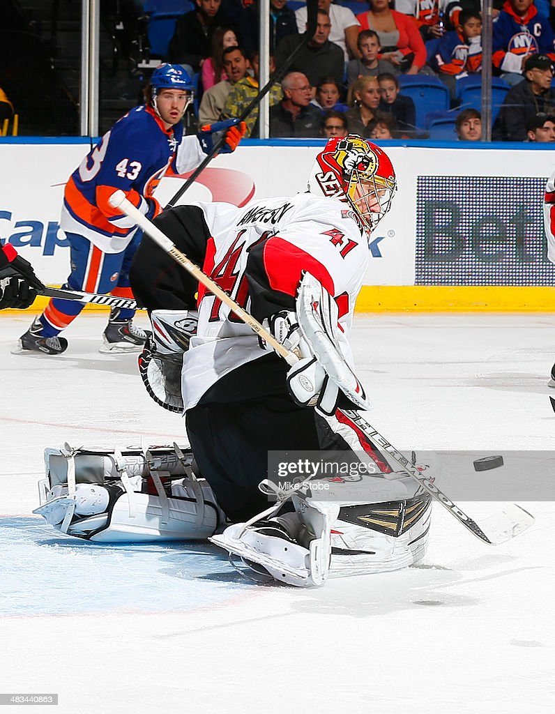 Goaltender <a gi-track='captionPersonalityLinkClicked' href=/galleries/search?phrase=Craig+Anderson&family=editorial&specificpeople=211238 ng-click='$event.stopPropagation()'>Craig Anderson</a> #41 of the Ottawa Senators makes a stick save against the New York Islanders at Nassau Veterans Memorial Coliseum on April 8, 2014 in Uniondale, New York.