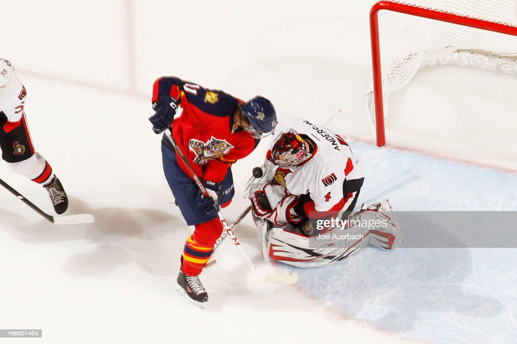 Goaltender Craig Anderson #41 of the Ottawa Senators stops a shot by <a gi-track='captionPersonalityLinkClicked' href=/galleries/search?phrase=Jonathan+Huberdeau&family=editorial&specificpeople=7144196 ng-click='$event.stopPropagation()'>Jonathan Huberdeau</a> #11 of the Florida Panthers in the second period at the BB&T Center on April 7, 2013 in Sunrise, Florida. The Panthers defeated the Senators 2-1.