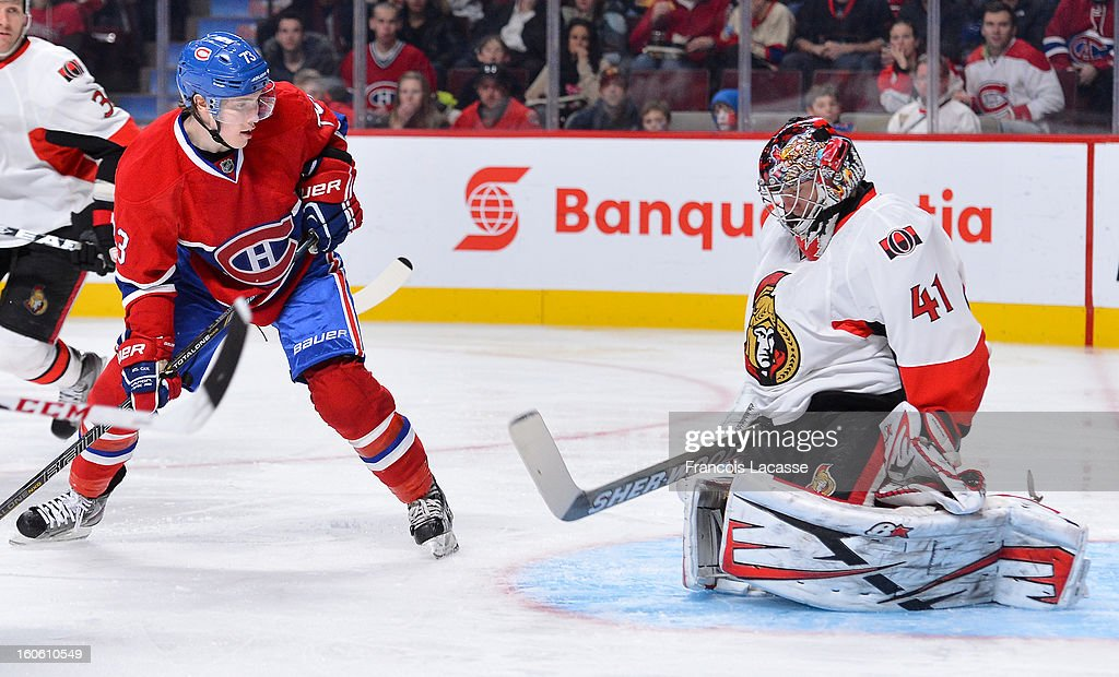 Goaltender <a gi-track='captionPersonalityLinkClicked' href=/galleries/search?phrase=Craig+Anderson&family=editorial&specificpeople=211238 ng-click='$event.stopPropagation()'>Craig Anderson</a> #41of the Ottawa Senators stops a shot as Brendan Gallagher #73 of the Montreal Canadiens waits for a rebound during the NHL game on February 3, 2013 at the Bell Centre in Montreal, Quebec, Canada.