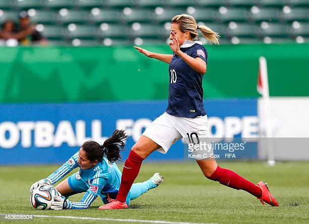Goaltender Cristina Recalde of Paraguay saves a loose ball against Claire Lavogez of France during the FIFA U20 Women's World Cup Canada 2014 Group D...
