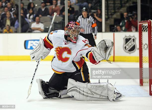 Goaltender Curtis Joseph of the Calgary Flames defends his net against the Dallas Stars during their NHL game at the American Airlines Center on...