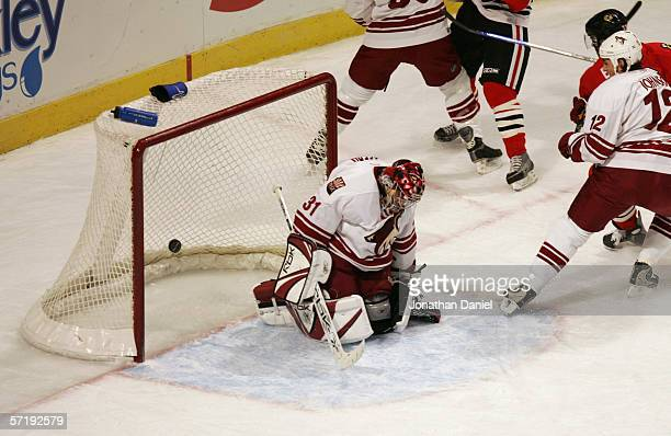 Goaltender Curtis Joseph the Phoenix Coyotes misses the puck during the game against the Chicago Blackhawks on March 19 2006 at the United Center in...