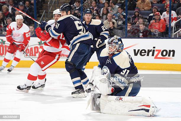 Goaltender Curtis McElhinney of the Columbus Blue Jackets blocks a shot against the Detroit Red Wings during the second period on March 25 2014 at...