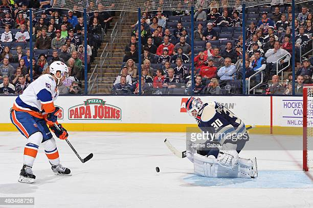 Goaltender Curtis McElhinney of the Columbus Blue Jackets blocks a breakaway shot by Frans Nielsen of the New York Islanders during the second period...