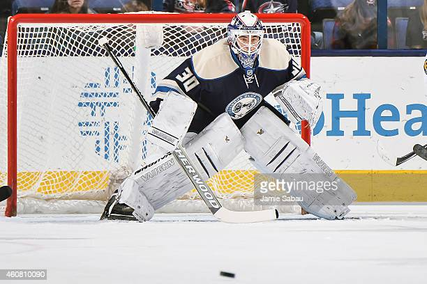 Goaltender Curtis McElhinney of the Columbus Blue Jackets defends the net against the Nashville Predators on December 22 2014 at Nationwide Arena in...
