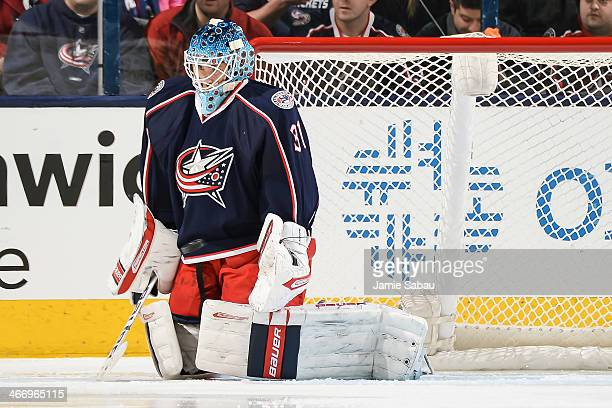 Goaltender Curtis McElhinney of the Columbus Blue Jackets defends the net against the Ottawa Senators on January 28 2014 at Nationwide Arena in...