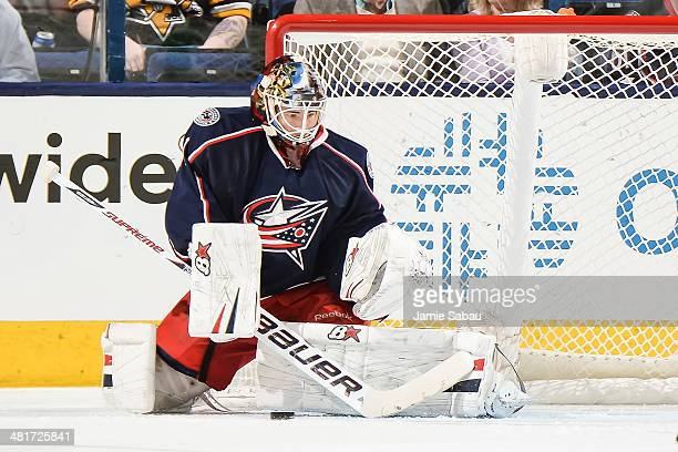 Goaltender Curtis McElhinney of the Columbus Blue Jackets defends the net against the Pittsburgh Penguinson March 28 2014 at Nationwide Arena in...