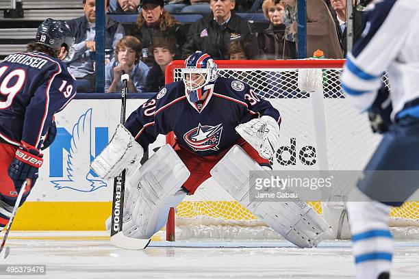 Goaltender Curtis McElhinney of the Columbus Blue Jackets defends the net against the Winnipeg Jets on October 31 2015 at Nationwide Arena in...
