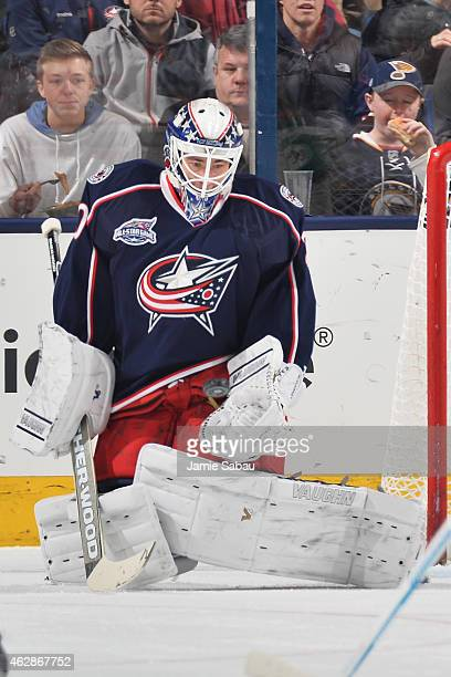 Goaltender Curtis McElhinney of the Columbus Blue Jackets makes a save during the first period of a game against the St Louis Blues on February 6...