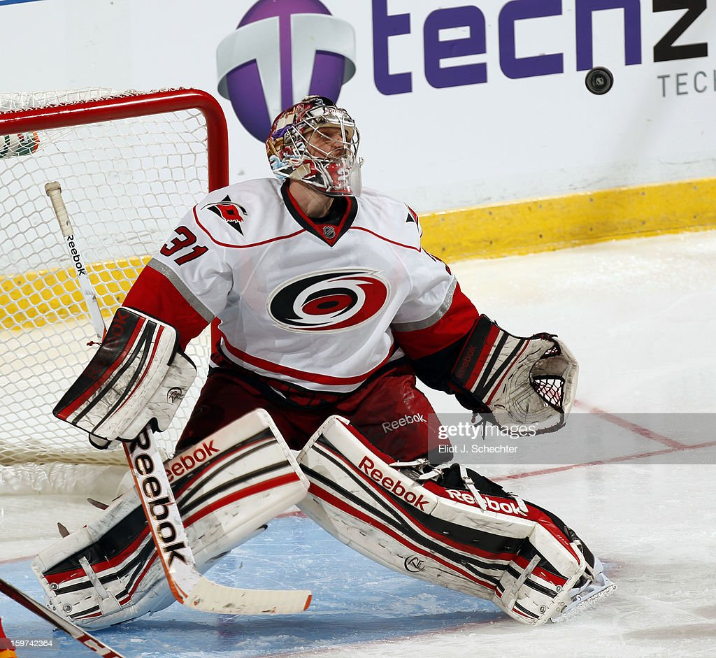 Goaltender <a gi-track='captionPersonalityLinkClicked' href=/galleries/search?phrase=Dan+Ellis&family=editorial&specificpeople=2235265 ng-click='$event.stopPropagation()'>Dan Ellis</a> #31 of the Carolina Hurricanes defends the net against the Florida Panthers at the BB&T Center on January 19, 2013 in Sunrise, Florida.