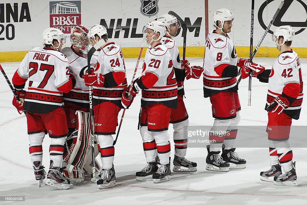 Goaltender <a gi-track='captionPersonalityLinkClicked' href=/galleries/search?phrase=Dan+Ellis&family=editorial&specificpeople=2235265 ng-click='$event.stopPropagation()'>Dan Ellis</a> #31 of the Carolina Hurricanes is congratulated by teammates after the game against the Florida Panthers at the BB&T Center on March 3, 2013 in Sunrise, Florida. The Hurricanes defeated the Panthers 3-2.