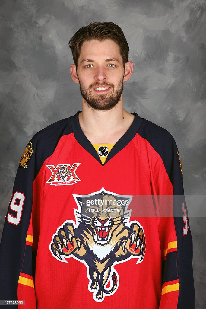 Goaltender <a gi-track='captionPersonalityLinkClicked' href=/galleries/search?phrase=Dan+Ellis&family=editorial&specificpeople=2235265 ng-click='$event.stopPropagation()'>Dan Ellis</a> #39 of the Florida Panthers poses for his official headshot for the 2013-2014 NHL season.
