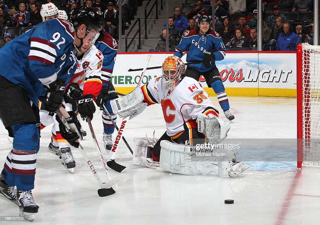 Goaltender Daniel Taylor #41 of the Calgary Flames blocks a shot against <a gi-track='captionPersonalityLinkClicked' href=/galleries/search?phrase=Gabriel+Landeskog&family=editorial&specificpeople=6590816 ng-click='$event.stopPropagation()'>Gabriel Landeskog</a> #92 of the Colorado Avalanche at the Pepsi Center on April 8, 2013 in Denver, Colorado. Calgary beat Colorado 3-1.