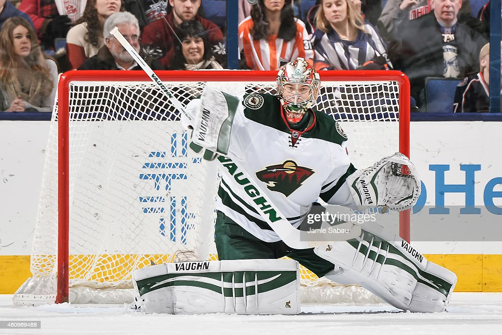 Goaltender Darcy Kuemper of the Minnesota Wild defends the net against the Columbus Blue Jackets on December 31 2014 at Nationwide Arena in Columbus...