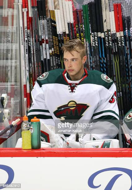 Goaltender Darcy Kuemper of the Minnesota Wild looks on from the bench after being pulled during third period action against the Winnipeg Jets at the...