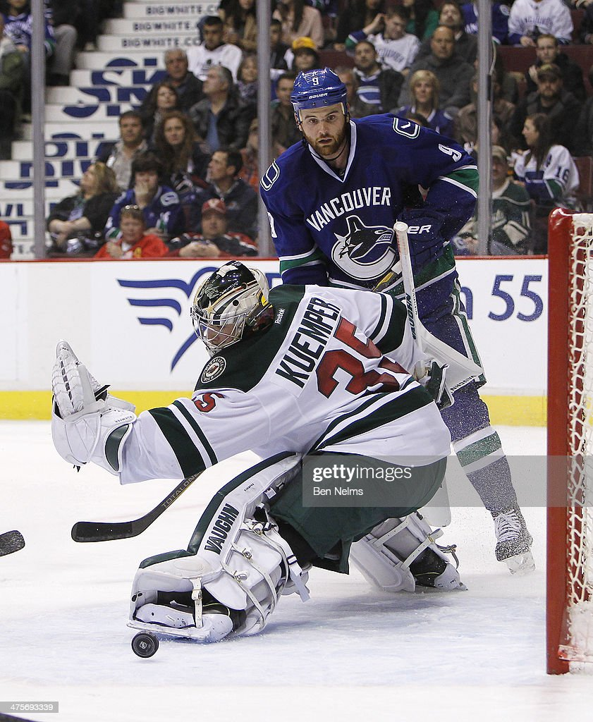 Goaltender Darcy Kuemper of the Minnesota Wild makes a save against Zack Kassian of the Vancouver Canucks during the second period of their NHL game...