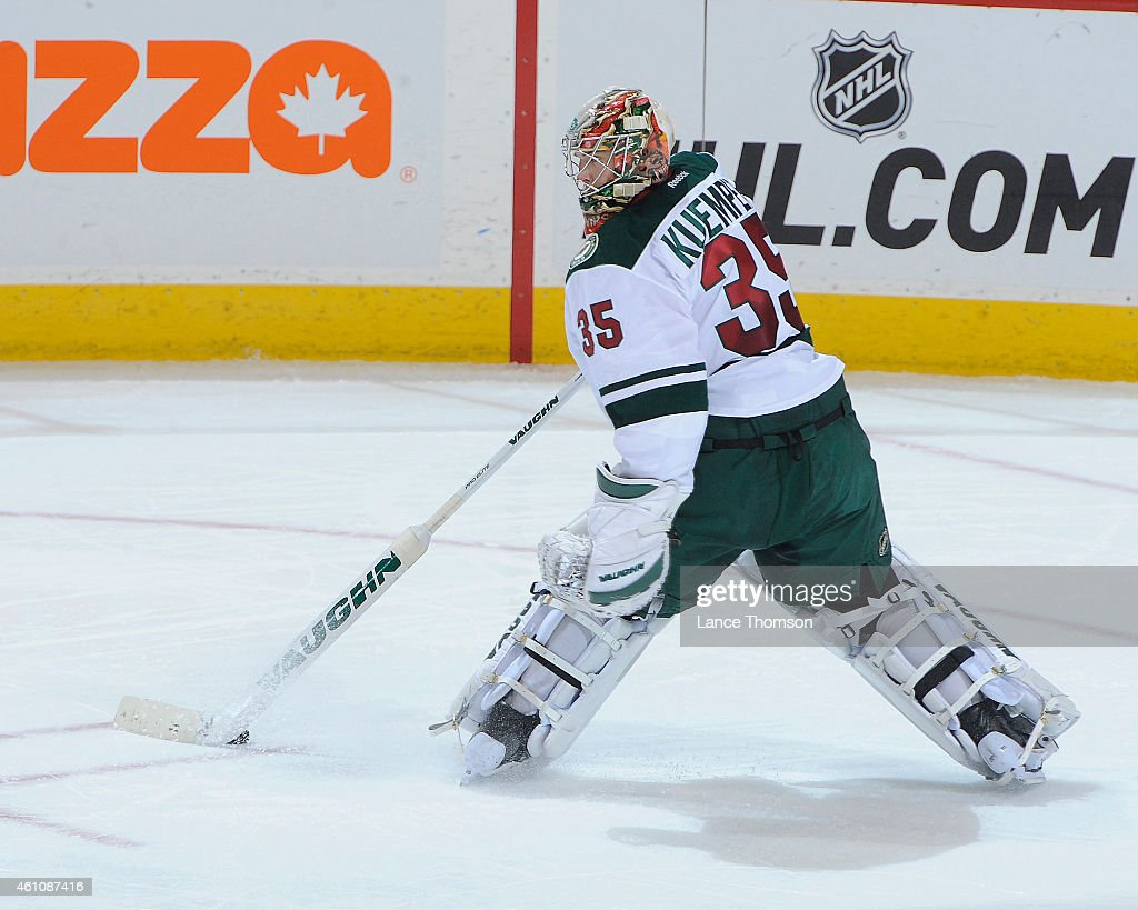 Goaltender Darcy Kuemper of the Minnesota Wild plays the puck during second period action against the Winnipeg Jets on December 29 2014 at the MTS...