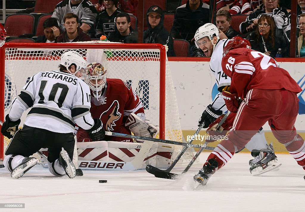 Goaltender Devan Dubnyk #40 of the Arizona Coyotes makes a save in front of Mike Richards #10 and Dwight King #74 of the Los Angeles Kings as Michael Stone #26 of the Coyotes looks to clear the puck during the third period at Gila River Arena on December 4, 2014 in Glendale, Arizona.
