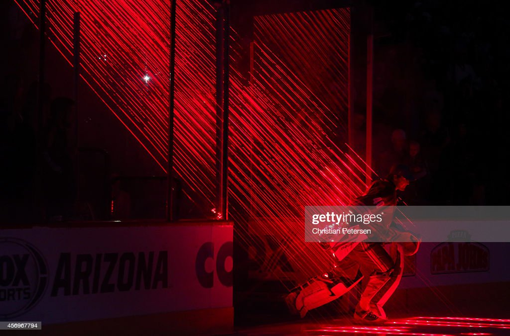 Goaltender Devan Dubnyk of the Arizona Coyotes skates out onto the ice before the NHL game against the Winnipeg Jets at Gila River Arena on October 9...