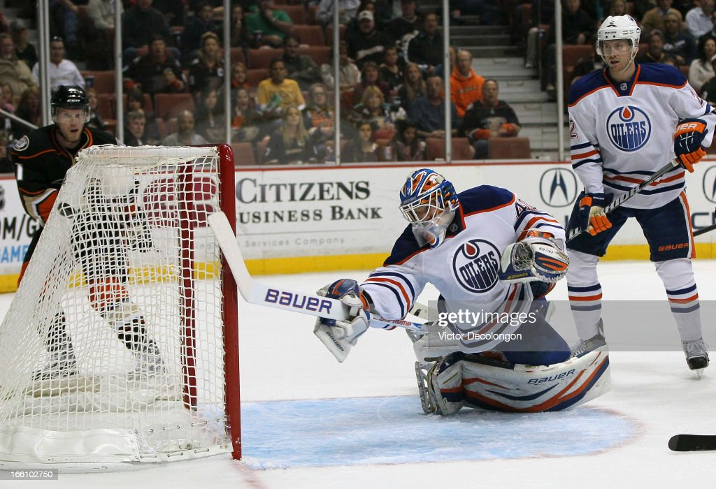 Goaltender Devan Dubnyk #40 of the Edmonton Oilers can't make the save on a shot for a goal by Radek Dvorak #18 of the Anaheim Ducks (not in photo) as Jeff Petry #2 of the Edmonton Oilers and Saku Koivu #11 of the Anaheim Ducks look on in the first period during the NHL game at Honda Center on April 8, 2013 in Anaheim, California.