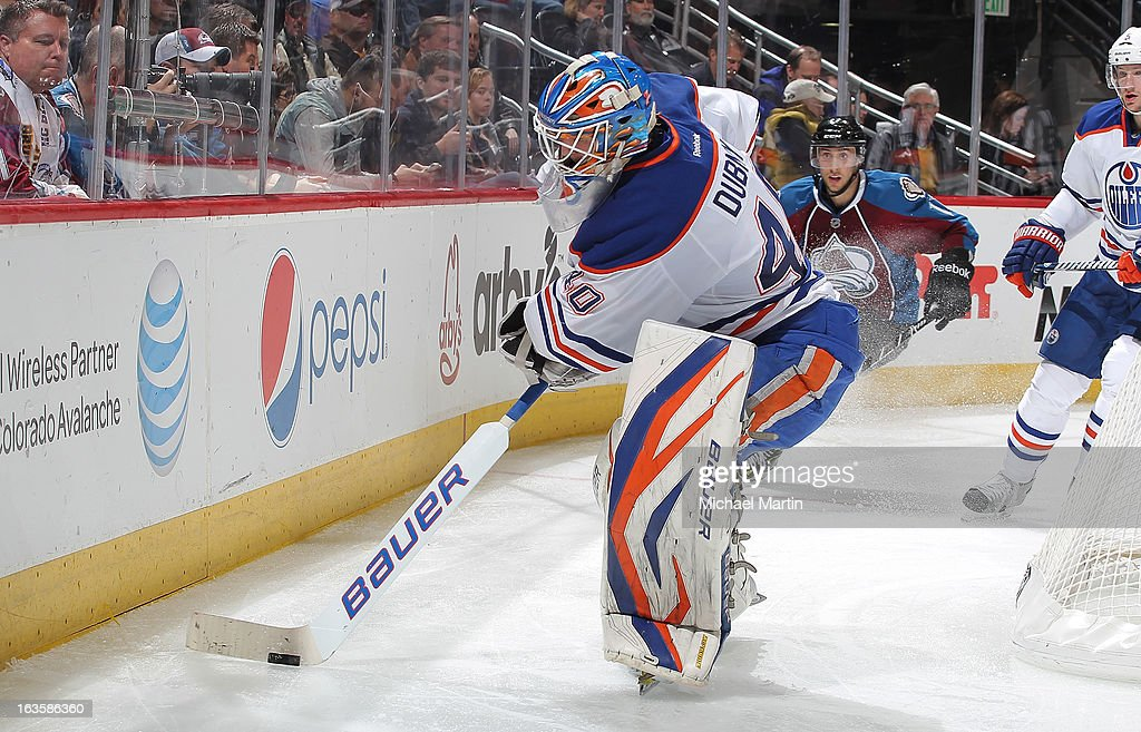 Goaltender <a gi-track='captionPersonalityLinkClicked' href=/galleries/search?phrase=Devan+Dubnyk&family=editorial&specificpeople=2089794 ng-click='$event.stopPropagation()'>Devan Dubnyk</a> #40 of the Edmonton Oilers clears the puck against the Colorado Avalanche at the Pepsi Center on March 12, 2013 in Denver, Colorado. Edmonton defeated Colorado 4-0.
