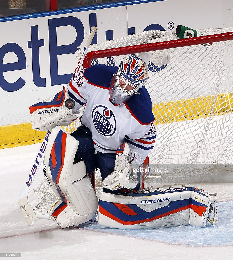 Goaltender <a gi-track='captionPersonalityLinkClicked' href=/galleries/search?phrase=Devan+Dubnyk&family=editorial&specificpeople=2089794 ng-click='$event.stopPropagation()'>Devan Dubnyk</a> #40 of the Edmonton Oilers defends the net against the Florida Panthers at the BB&T Center on November 5, 2013 in Sunrise, Florida.