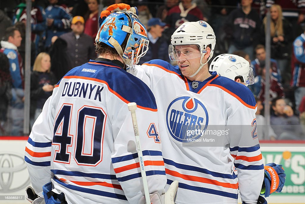 Goaltender <a gi-track='captionPersonalityLinkClicked' href=/galleries/search?phrase=Devan+Dubnyk&family=editorial&specificpeople=2089794 ng-click='$event.stopPropagation()'>Devan Dubnyk</a> #40 of the Edmonton Oilers is congratulated my teammate Jeff Petry #2 after the shutout against the Colorado Avalanche at the Pepsi Center on March 12, 2013 in Denver, Colorado. Edmonton defeated Colorado 4-0.