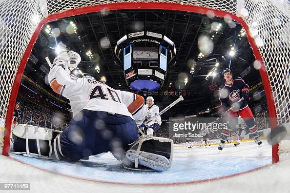 Goaltender Devan Dubnyk of the Edmonton Oilers is unable to stop a shot from Marc Methot of the Columbus Blue Jackets during the third period on...