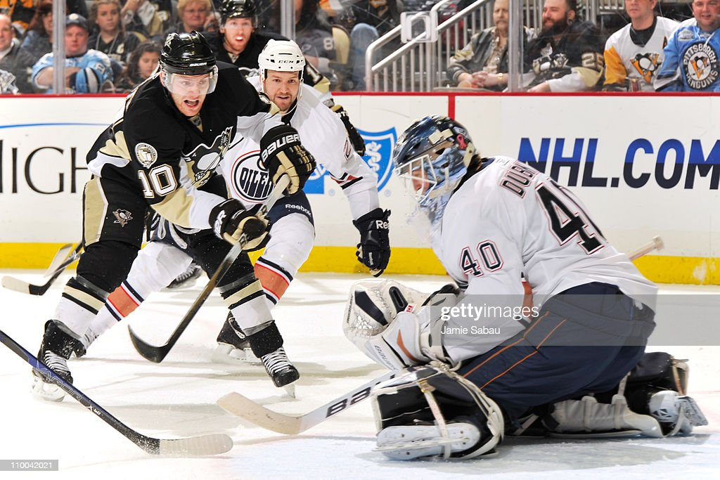 Goaltender Devan Dubnyk #40 of the Edmonton Oilers makes a save on a shot from Mark Letestu #10 of the Pittsburgh Penguins on March 13, 2011 at CONSOL Energy Center in Pittsburgh, Pennsylvania.