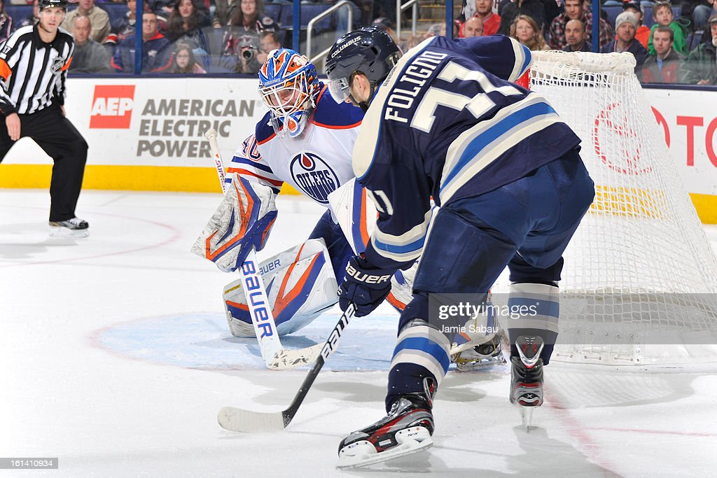 Goaltender <a gi-track='captionPersonalityLinkClicked' href=/galleries/search?phrase=Devan+Dubnyk&family=editorial&specificpeople=2089794 ng-click='$event.stopPropagation()'>Devan Dubnyk</a> #40 of the Edmonton Oilers waits for a shot from <a gi-track='captionPersonalityLinkClicked' href=/galleries/search?phrase=Nick+Foligno&family=editorial&specificpeople=537821 ng-click='$event.stopPropagation()'>Nick Foligno</a> #71 of the Columbus Blue Jackets in the third period on February 10, 2013 at Nationwide Arena in Columbus, Ohio. Dubnyk had 39 saves in Edmonton's 3-1 win over Columbus.