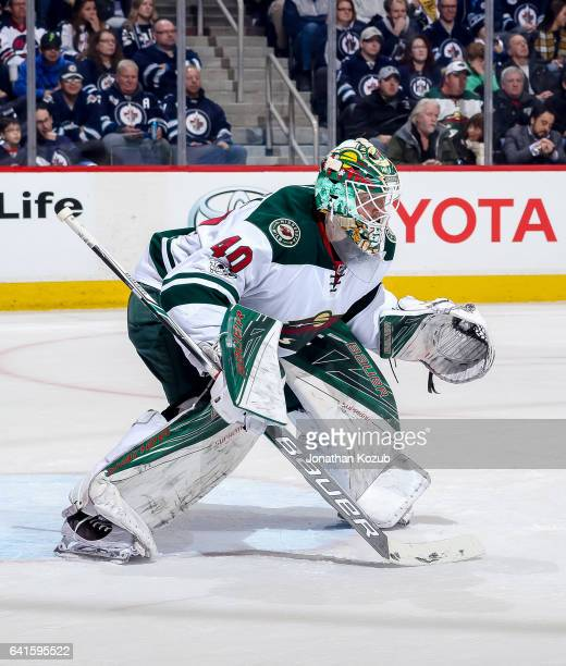 Goaltender Devan Dubnyk of the Minnesota Wild guards the net during second period action against the Winnipeg Jets at the MTS Centre on February 7...