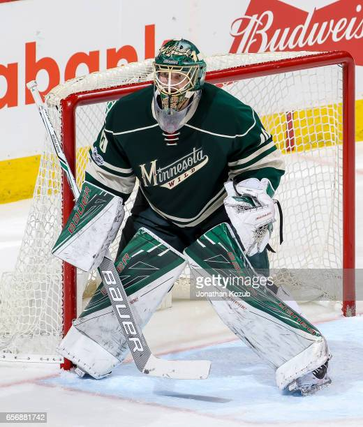 Goaltender Devan Dubnyk of the Minnesota Wild guards the net during third period action against the Winnipeg Jets at the MTS Centre on March 19 2017...