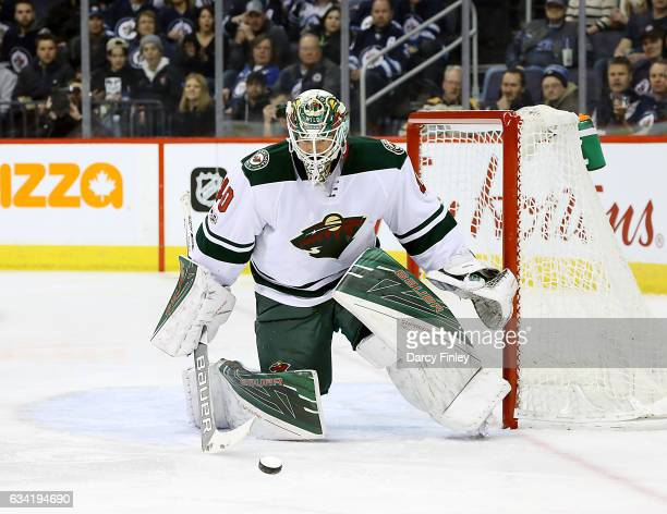 Goaltender Devan Dubnyk of the Minnesota Wild keeps an eye on the loose puck during first period action against the Winnipeg Jets at the MTS Centre...