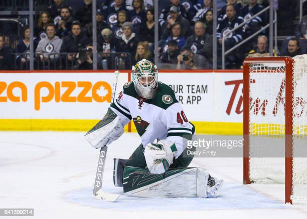 Goaltender Devan Dubnyk of the Minnesota Wild keeps an eye on the play during first period action against the Winnipeg Jets at the MTS Centre on...