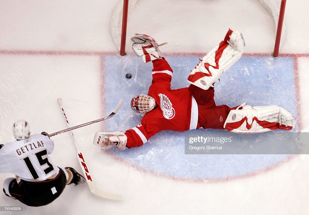Goaltender Dominik Hasek of the Detroit Red Wings makes a diving save on the shot from Ryan Getzlaf of the Anaheim Ducks during the first period of...