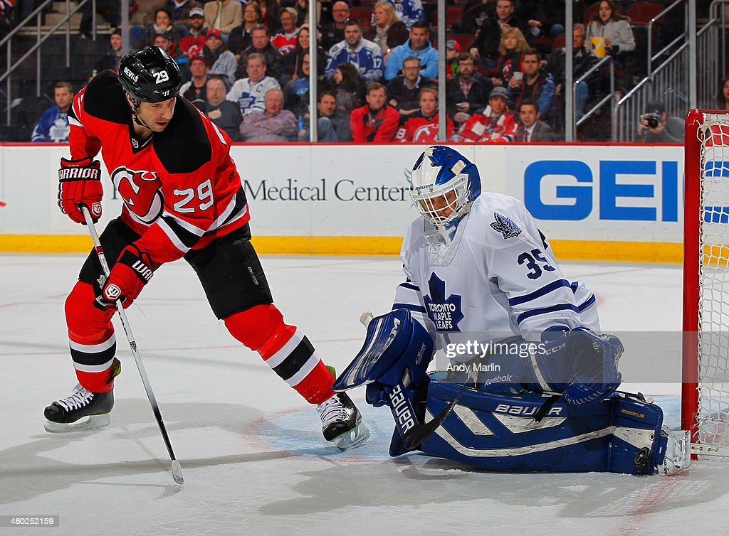 Goaltender Drew Macintyre #35 of the Toronto Maple Leafs, playing in his first game of the season, makes a save as Ryane Clowe #29 of the New Jersey Devils looks for a rebound during the game at the Prudential Center on March 23, 2014 in Newark, New Jersey.