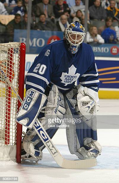 Goaltender Ed Belfour of the Toronto Maple Leafs eyes the play in the corner during the game against the Tampa Bay Lightning at Air Canada Centre on...