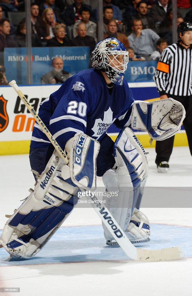 Goaltender Ed Belfour #20 of the Toronto Maple Leafs gets set for a shot from the Washington Capitals during their NHL game on October 13, 2003 at Air Canada Centre in Toronto, Ontario, Canada. The Maple Leafs and the Capitals skated to a 2-2 tie.