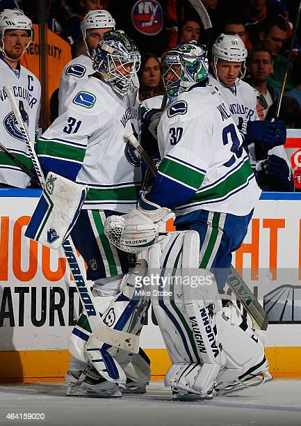 Goaltender Eddie Lack enters the game after teammate Ryan Miller of the Vancouver Canucks is injured during the second period at Nassau Veterans...