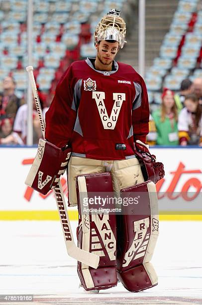 Goaltender Eddie Lack of the Vancouver Canucks attends practice for the 2014 Tim Hortons NHL Heritage Classic game against the Ottawa Senators at BC...
